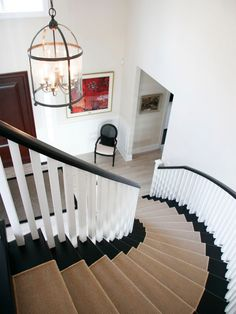 Black staircase with white and sisal runner