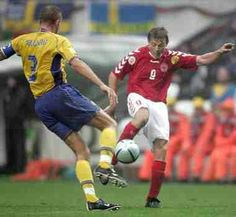 Denmark 2 Sweden 2 in 2004 in Porto. Jon Dahl Tomasson scored after 28 minutes in Group C at Euro 2004.