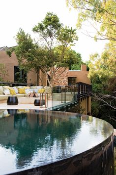 Round infinity pool & fire pit lounge area Joburg Tree House