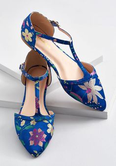 Turn Back Prime T-Strap Flat The best way to relive memories of jaunts enjoyed in these sapphire blue flats? Buckling into their T-straps and letting the good times roll - again! With each step taken in the pointed toes and floral brocade of this statement pair from our ModCloth namesake label, you'll recall fond moments while forming new, unforgettable ones.  Psst - these kicks also come in wide sizes!  Similar Items