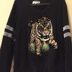 I just discovered this while shopping on Poshmark: Wildfox tiger spirit v neck jumper. Check it out!  Size: M