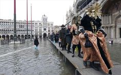 Two revellers wear stunning costumes and lavish masks as they lead civilians over the temporary walkway on Sunday in the floating city Carnival 2015, Travel News, Great Photos, Masquerade, Venice, To Go, Winter Jackets, Street View, Glamour