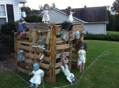 zombie doll playhouse. made out of pallets - I know a boy that would LOVE to make this for target practice in the backyard :-)