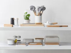 the extensive collection includes kitchen utensils, salt and peper grinders, oil and vinegar cruets, bread and cheese boards, butter dish, parmesan grater, mortar and pestles, juicer, folding trivet, and a self-watering herb pot.