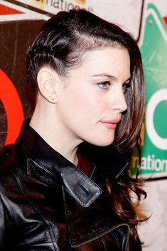 The easiest way to take a sideswept style from glamorous to edgy is to add a braid. Liv Tyler's cornrow stretched from ear to nape.