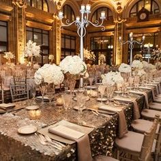 The long head table was decked out in a metallic sequined tablecloth that sparkled in the candlelight. Crystal vases held round bunches of cream and white roses and hydrangeas.