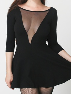 Ponte Gloria V Skater Dress from American Apparel. Super deep v-neck with mesh, scoop back, and full a-line cut. Quarter length sleeves. Available in black or blue. $58