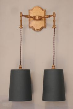 VENICE wall light. - Empel Collections. Cast bronze and brass parts. Shown here in a gold leaf, with a bronzy finish. Shown with optional tapered drum shades.  Many finishes and shade options available.  See added scale study for dims on the double version.  Of course you can ask us to alter any dim.
