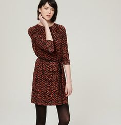 """In a seriously striking print, we heart the casually femme appeal of this easygoing knit. Jewel neck. Long sleeves. Shirred beneath front and back yoke. Removable waist tie. Keyhole detail at back neck with button closure. 20"""" from natural waist."""