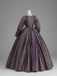 Day dress, silk taffeta trimmed with silk ribbon and fringed decorative buttons, ca. 1859