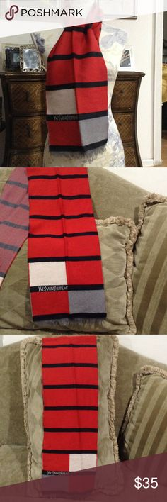 Yves SaintLaurent Wool Scarf Red , blue And gray. 100% wool . Made in W.Germany Vintage.  This scarf does have some damage. One half is great . But the other has a few pulls or small holes. Yves Saint Laurent Accessories Scarves & Wraps
