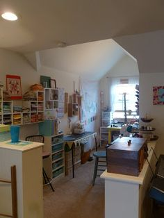 The blogger at Pink Castle Fabrics uses a few wooden bookshelves to separate her family room and her sewing area. She has a ton of stuff in this rectangular nook. Lots of pictures at the source.