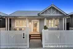 Sticks and Wombat's abode features a white picket fence that leads the way to a grey and white Period façade White Exterior Houses, Grey Houses, House Paint Exterior, Facade Design, Fence Design, House Design, Weatherboard House, California Bungalow, Front Yard Fence