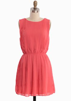 """Whispering Peony Pleated Dress 45.99 at shopruche.com. Crafted in a coral shade as juicy as sun kissed citrus fruit, this breezy chiffon dress is complemented with countless sunburst pleats for graceful movement and luxurious texture. Finished with an alluring surplice back and an elasticized waist for a flattering silhouette. Fully lined.100% Polyester, Imported, 32"""" length from top of shoulders, 34"""" bust,..."""