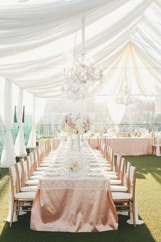 Long Tables in U-Shape under sheer draping -- Lace topper on peach/pink table linens. Love, love, love!!