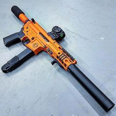 Another orange and black gun! Weapons Guns, Airsoft Guns, Guns And Ammo, Zombie Weapons, Rifles, Arsenal, Revolver, Ar15, Ar Pistol