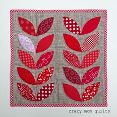 Playful Petals mini quilt by Crazy Mom Quilts, book by Corey Yoder