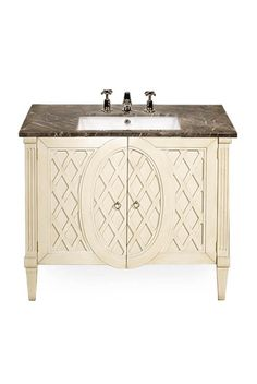The Cambon is a beautifully hand-carved vanity unit, shown in Light Grey with an Imperial marble top.