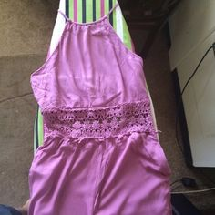 Pink Jumpsuit A pink jumpsuit featuring an crochet in the middle, a crew neck and shows your back little, a contrast hem, and an invisible side zipper. MAKE AN OFFER OR DO A BUNDLE Forever 21 Dresses Maxi