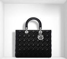 A timeless and unique work of art, the Lady Dior bag is imbued with the  Couture spirit of Dior. Meticulously crafted by hand, this large black  lambskin bag ... d9d82c5bc3