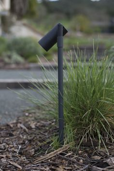 Unobtrusive pathway lights blend into the landscape; the Architects Path Light from Lightcraft is $80 at Yard Illumination. An LED light bulb, sold separately, is available in three wattages for $26 to $43, depending on the wattage. Photograph by Andres Gonzalez.