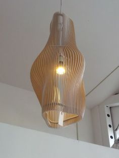 Laser-cut plywood at a boutique on Valencia. Cant find any info online. Light Fittings, Light Fixtures, Modern Lighting, Lighting Design, Lampe Laser, Laser Cut Lamps, Laser Cut Plywood, Laser Cutting, Gravure Laser