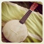 My DIY Banjo Mandolin - 6 string. Made from a old ukulele neck and tambourine. Real simple to make. Sounds great.