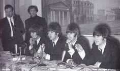 The Beatles with Brian Epstein and Neil Aspinall attend a press conference at the Savile Theatre after receiving MBE's from Buckingham Palace, 26 October 1965