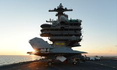 ATLANTIC OCEAN (May 14, 2013) An X-47B Unmanned Combat Air System (UCAS) demonstrator is lifted on an aircraft elevator aboard the aircraft carrier USS George H.W. Bush (CVN 77).(U.S. Navy photo by Mass Communication Specialist 2nd Class Tony D. Curtis/Released)
