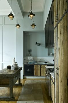 Kitchen in Paris - beautiful colour scheme but dunno whey there is a path in the floor