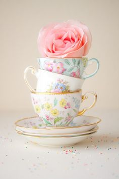 tea cups and a rose.