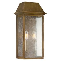 Outdoor wall sconce with a burnished copper finish and seeded glass panels.  Product: Wall sconceConstruction Materi...