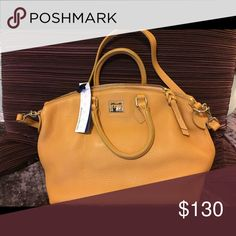 Dooney & Bourke Satchel 6L968 This bag is new with tags. It is big and roomy. There is a crease line on the front of the purse from storage. This is visible on the left side in the picture. The color is called chamois. Dooney & Bourke Bags Satchels