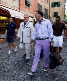 Sir Elton John and David Furnish go shopping on August 12, 2008 in Portofino, Italy.