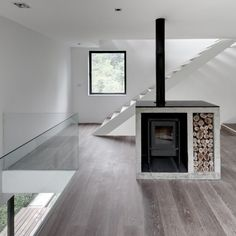 Firepalce and stairs at  Alta House. Architects: AS/D Asociacion de Diseño. Location: Huixquilucan, México