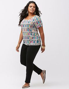 Soft tee with an all-over nail polish conversation print perks up your casual day look with metallic print. Flattering scoop neck and short sleeves. lanebryant.com