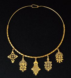 Gold cross pendant necklace circa 20th century from Ethiopia.