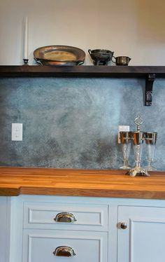 Instead of tile have a backsplash of galvanized fit your space, wipe on the solution and thats it!