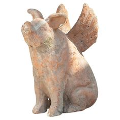 Terracotta flying pig garden statue.  Product: StatueConstruction Material: TerracottaColor: Natural
