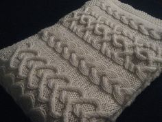 Levi's baby blanket - three cable patterns to represent the family - a nice pattern