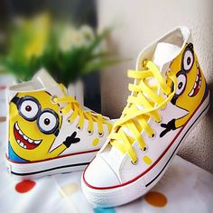 Ramp your favorite cartoon character to the city with this hand painted minion sneakers. This features semi high cut design,lace with metalic eyelets closure, flat heel and a lovely minion print. Craf