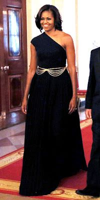 Night's Look: Love it or Leave it? First Lady Michelle Obama is wearing a black, one shoulder Michael Kors gown with a drapped chain belt.First Lady Michelle Obama is wearing a black, one shoulder Michael Kors gown with a drapped chain belt. Michelle Obama Flotus, Barak And Michelle Obama, Michelle Obama Fashion, Barack Obama Family, Obamas Family, American First Ladies, Michael Kors, Style And Grace, Classy Women