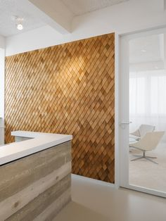 Different way to add wood wall to the lower level. Shingles on diagonal.