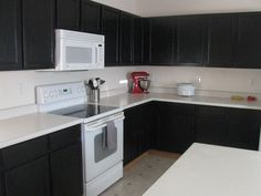 Painted Cabinets Before and After: Ideas for Your Kitchen Renovation: Painted Cabinets Before And After View 7.......I like this idea. My kitchen is the opposite (dark fake stone counters and light oak cabinets) Thinking about painting my cabinets dark and painting my counters lighter.