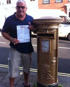 Police have arrested a man for spray painting a Royal Mail post box gold in honour of Olympic sailor Ben Ainslie.