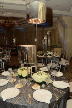 Lamp shades were used on some of these Bar Mitzvah centerpieces. | MitzvahMarket.com