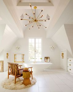 Beautiful white bathroom with gold chandelier