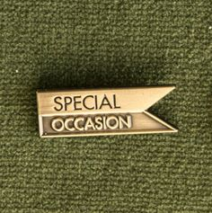 """It's a Special Occasion Pin!A little personal flag to help remind the world what a GOSHDARN NOTEWORTHY day it is. By Hooptedoodle. 1"""" across. Antique gold fin"""