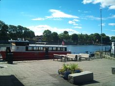 The ferry over the river Glomma looking over towards the Old Town and Fortress (Gamelbyen) of Fredrikstad, Norway.