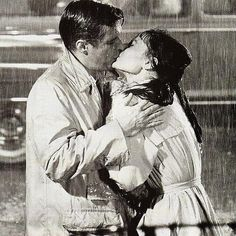 Audrey Hepburn and George Peppard famous kissing in the rain scene 'Breakfast at Tiffany's' 1961